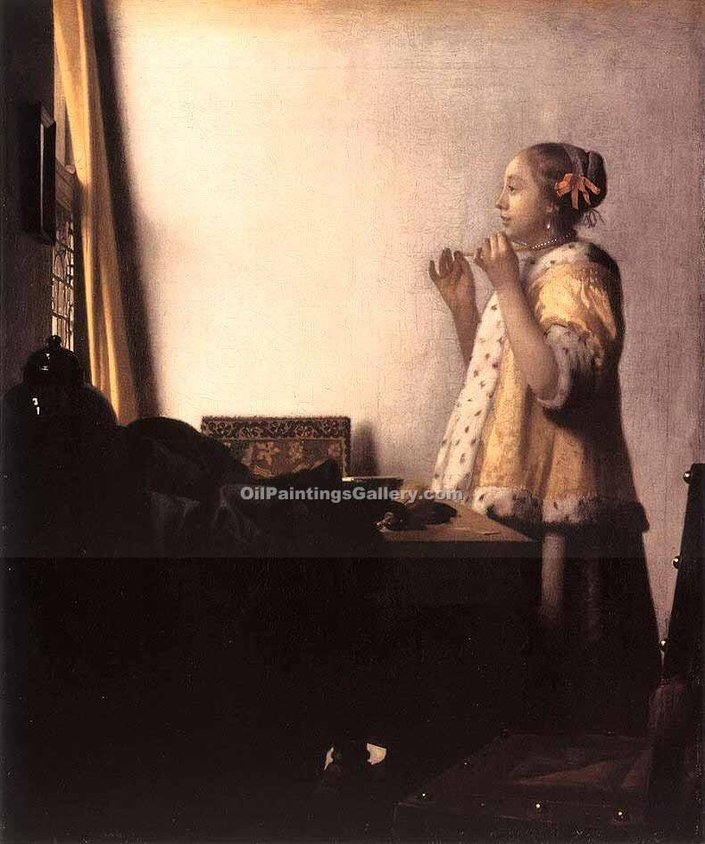 """Woman with a Pearl Necklace"" by  Jan Vermeer"